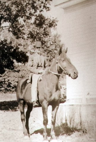 This is George allen outside the original wooden Free Union Bretheran church on site of current church. He rode this mule (I think it is a mule) to the three churches where he preached each sunday